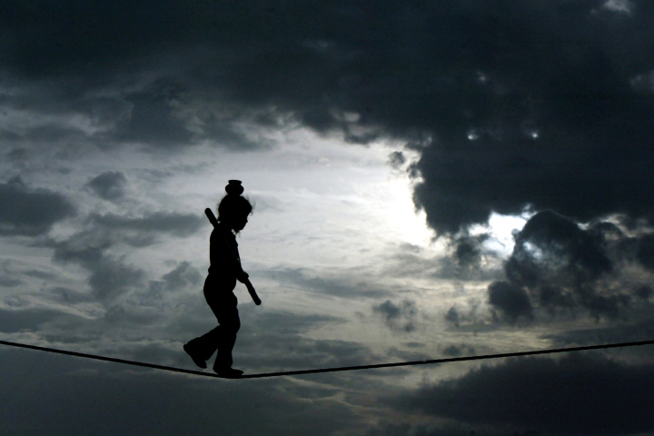A young Indian girl walks a tightrope to