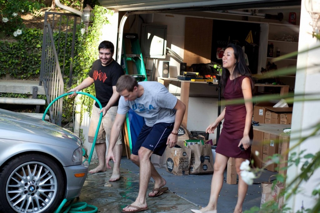 they-cant-put-the-car-in-the-garage-since-its-filled-with-displays-but-they-make-up-for-it-by-making-car-washes-a-team-activity