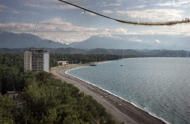 A view from the top, seen by a broken window glass, of the Pitsunda beach at the Black Sea.