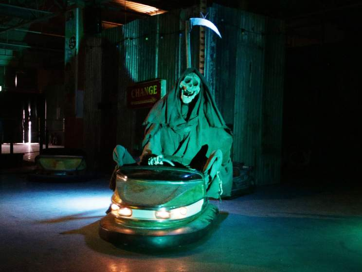 Image #: 38871583    The grim reaper rides the dodgems at Dismaland - Bemusement Park, Banksy's biggest show to date, in Western-super-Mare, Somerset.       PA PHOTOS /LANDOV