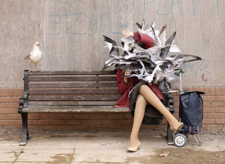 Image #: 38872291    A woman attacked by seagulls piece by Banksy, during the press view for the artistâ??s biggest show to date, entitled 'Dismaland', at Tropicana in Western-super-Mare, Somerset.       PA PHOTOS /LANDOV