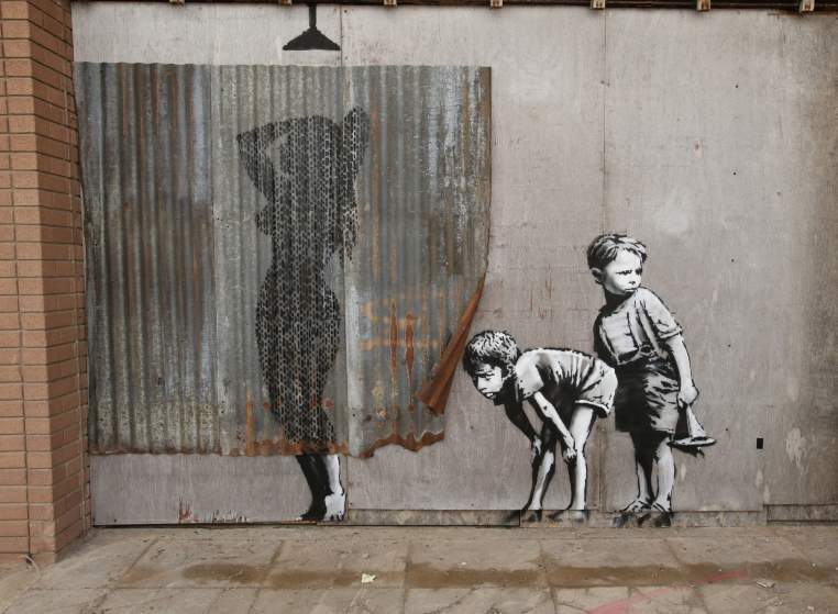 Image #: 38872261    A piece by Banksy, during the press view for the artistâ??s biggest show to date, entitled 'Dismaland', at Tropicana in Western-super-Mare, Somerset.       PA PHOTOS /LANDOV